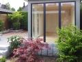 Transparent Gartensauna mit viel Glas